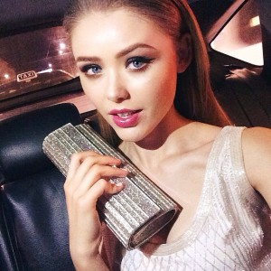 Ready for the night with my sparkly @jimmychooltd clutch! Heading to the @gucci beauty launch! Let's go
