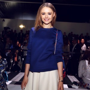 At the @roberto_cavalli show in one of their neoprene, navy blue sweaters and wearing @chopard jewels